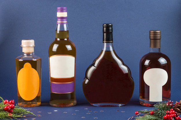 Bottles of whiskey and brandy on a dark blue background close-up. new year and christmas.