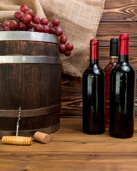Bottles of wine with barrel