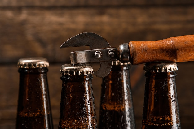 Bottles with beer and vintage opener