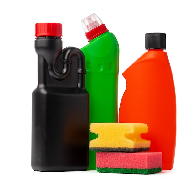 Bottles with cleaning products and sponge on a white isolated background