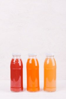 Bottles with colorful fruit juice