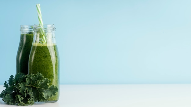 Bottles with copy space and green smoothie