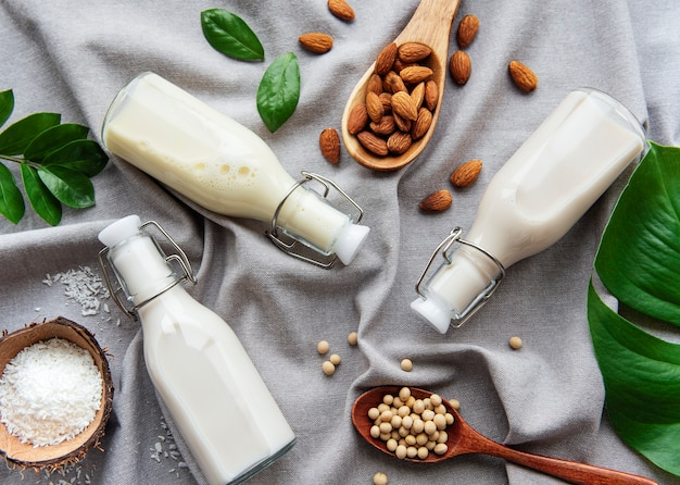 Bottles with different plant milk - soy, almond and oat milk