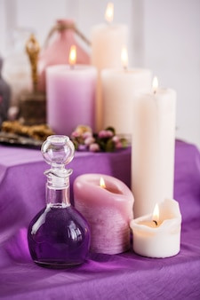 Bottles with essential aroma oil and aroma candles. spa setting