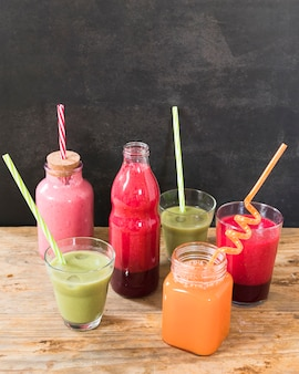 Bottles with fruits smoothie