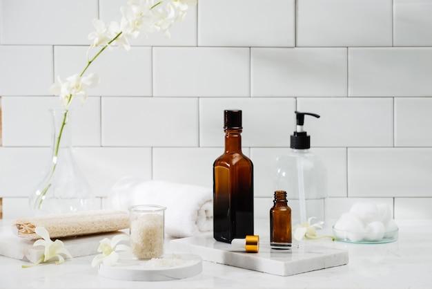 Bottles with massage essentials oils, towels and zen stones. spa composition.