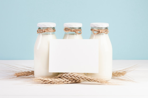 Bottles with milk and copy space card