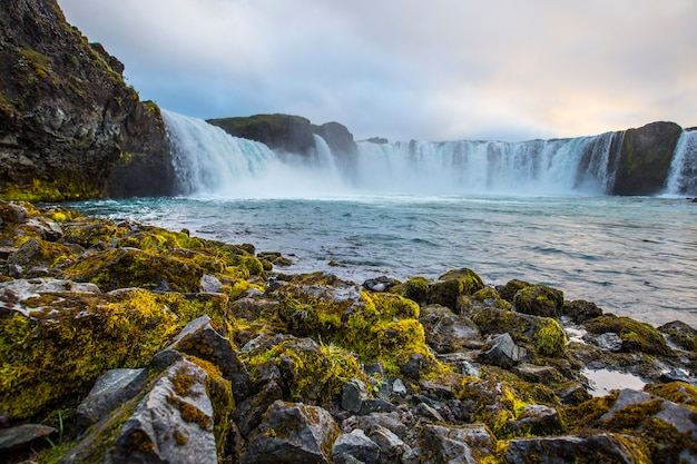 Bottom of godafoss waterfall with sunset in the background, iceland