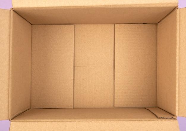 Bottom of open empty brown cardboard box