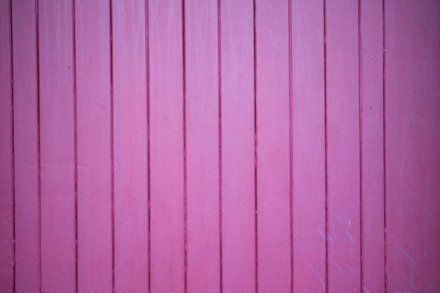 Bottom of vertical planks in bright pink or purple wood