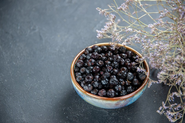 Bottom view black currant in bowl on isolated surface free place