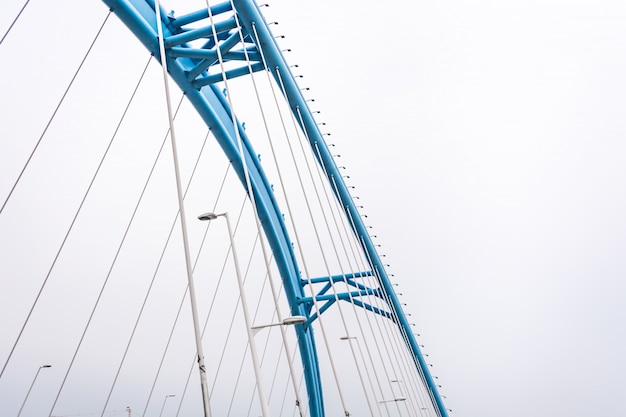Bottom view of bridge on a foggy day