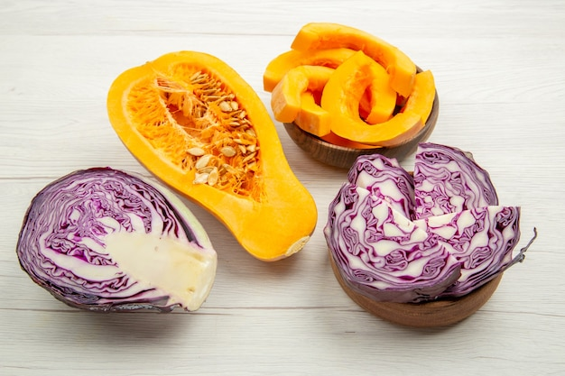Bottom view butternut squash squash slices in bowl cut red cabbage on grey wooden table