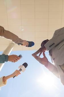 Bottom view man being interviewed
