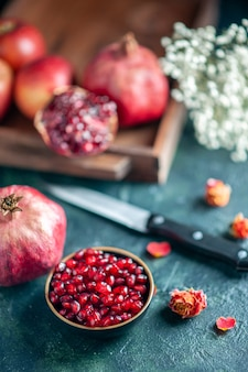 Bottom view pomegranate seeds bowl knife on table