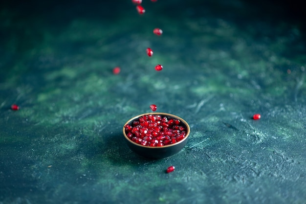 Bottom view pomegranate seeds bowl on table free space