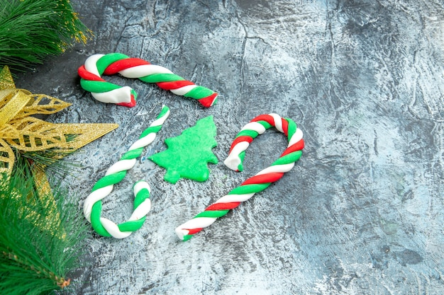 Bottom view xmas candies xmas ornaments on grey background with free space