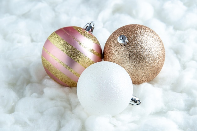 Bottom view xmas tree balls on white isolated surface