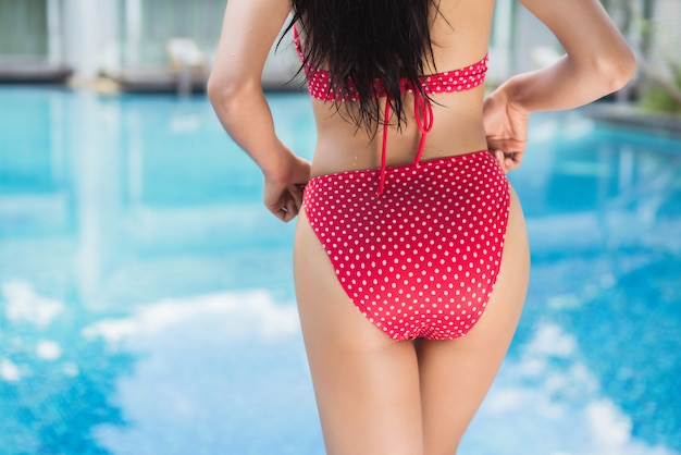 Bottom of women wearing bikinis