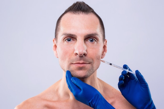 Botulinum therapy. close-up of person hands injecting syringe with botox for face treatment. esthetox