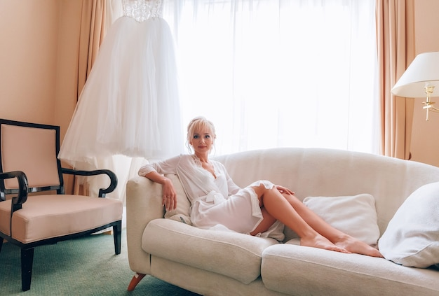 Boudoir of the bride. charming bride in the morning in a negligee prepares for the celebration