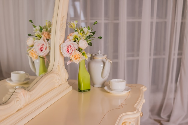 Boudoir table.  interior of the bedroom for girls and make-up, hairstyles with a mirror. good morning coffee in bed.boudoir table, dressing table.romantic design for bedroom.