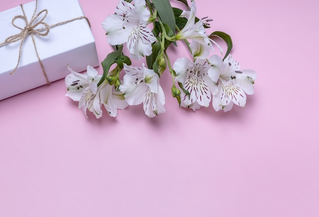 A bouquet of alstroemeria and a gift box