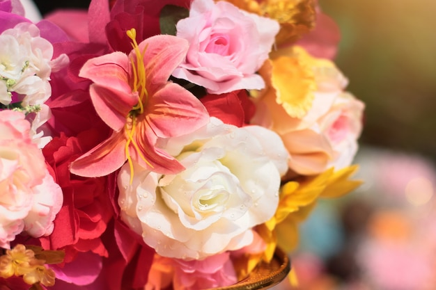 Bouquet of artificial flowers decoration in ceremony wedding.