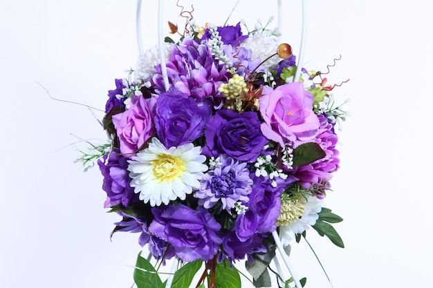 Bouquet of artificial purple flower colorful, white background