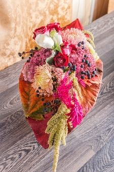 Bouquet of autumn flowers on a frame