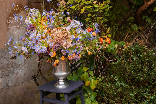 Bouquet of autumn wild flowers in a vase