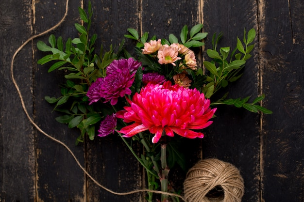 A bouquet of beautiful flowers for the holiday on wood
