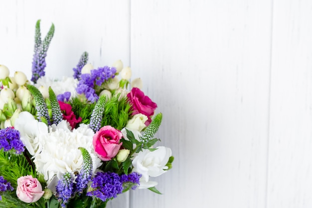 Bouquet of beautiful flowers on white background with copy space