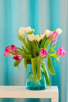 Bouquet of beautiful pink and tulips in tiffany vase.