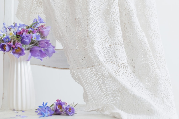 Bouquet of beautiful spring violet flowers on white