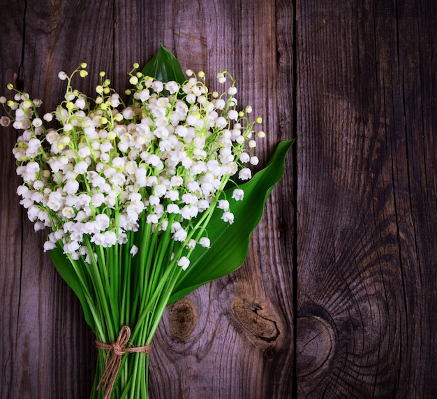 Bouquet of blossoming lilies of the valley