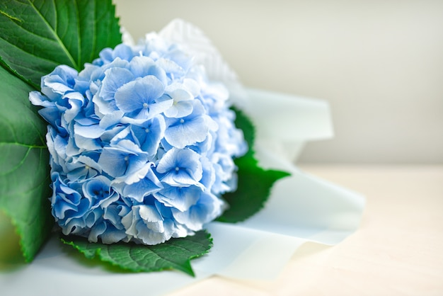 Bouquet of blue flowers on a table on a white background