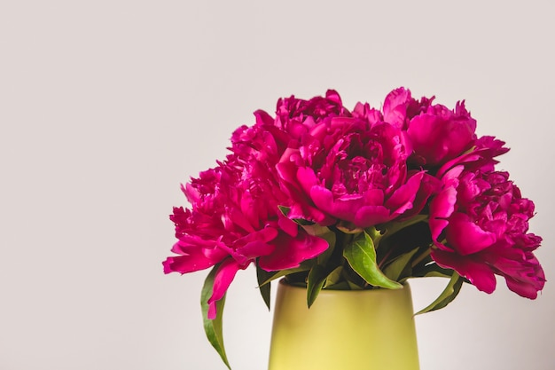 Bouquet of bright pink peonies in a vase