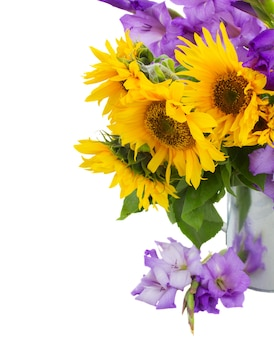 Bouquet of bright sunflowers with gladioluses close up isolated on whute