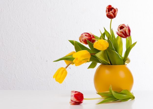 Bouquet of colorful tulips in vase