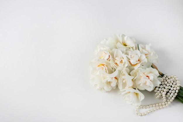 Bouquet of daffodils tied with a pearl ribbon