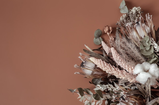 Bouquet of dried wildflowers, cotton and leaves composition