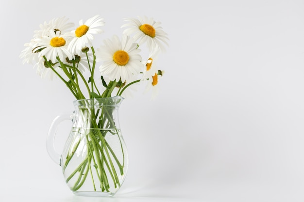 Bouquet of field daisies in a vintage