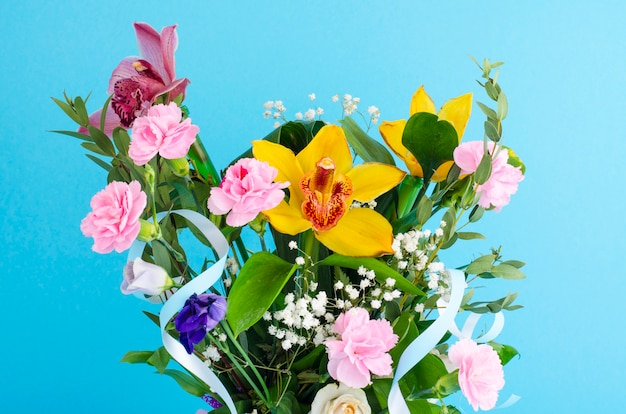 Bouquet of flowers on bright background.