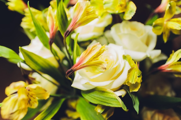 Bouquet of flowers consists of lilies and forget me nots.