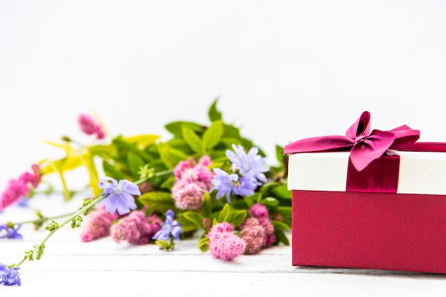 Bouquet of flowers and cute gift
