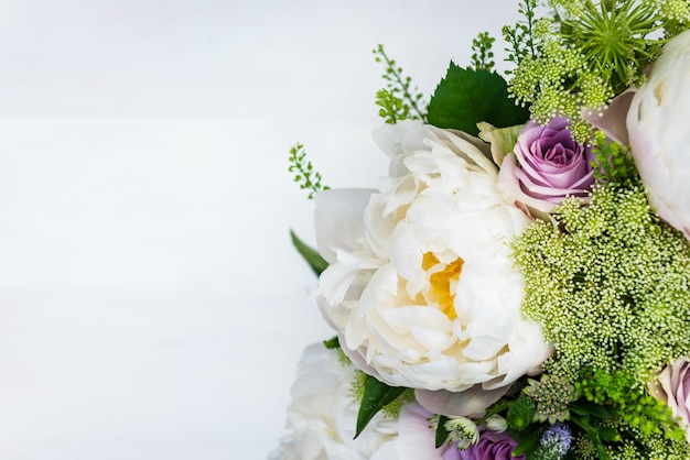 Bouquet of flowers from big peonies and pastel roses