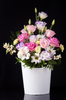 Bouquet of flowers from roses, lisianthus, daisies, chrysanthemums