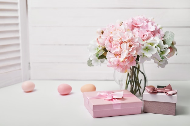 Bouquet of flowers and gift box