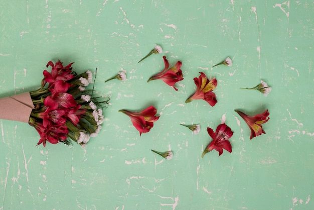Bouquet of flowers on green wooden surface